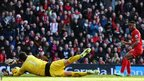 Raheem Sterling slides the ball past Cardiff City keeper David Marshall to make it 2-0 to Liverpool