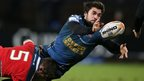 Gareth Owen is tackled by Munster's Billy Holland during the Scarlets' dramatic 16-10 defeat