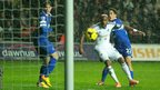 Swansea's Dwight Tiendalli watches his shot deflect into the goal to draw his side level against Everton at the Liberty Stadium