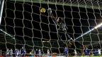 Swansea goalkeeper Gerhard Tremmel cannot stop Ross Barkley's late free-kick as Everton win 2-1 at the Liberty Stadium