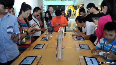 Customers looking at iPhones at an Apple store in China