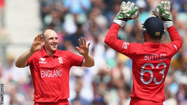 James Tredwell of England celebrates with Jos Buttler during the ICC Champions Trophy Semi-Final match between England and South Africa at The Kia Oval in June