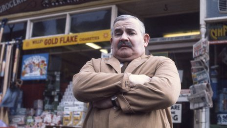 Arkwright outside the shop