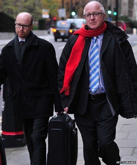 Denis MacShane, right, on his way to the court