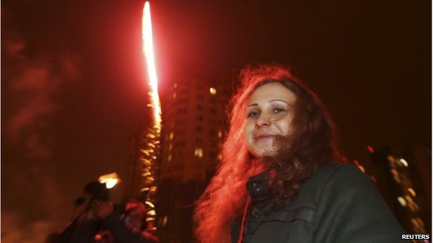 Maria Alyokhina near a decorative street light after her release from a penal colony in Nizhny Novgorod December 23