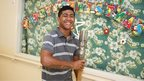 The Queen's Baton Relay arrives in a local hospital in Niue, as staff members pose for photograph with the baton.
