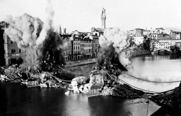 Two base supports of the wrecked Santa Trinita Bridge over the Arno River, in Florence, Italy, are dynamited by British Eighth Army Engineers as they prepare the way for the Building of a Bailey Bridge in its place, August 24, 1944