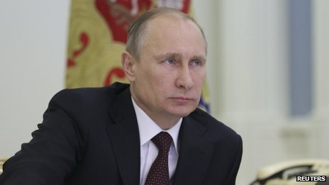Russian President Vladimir Putin takes part in a video conference in Moscow on 23 December, 2013