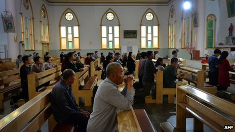 "Chinese Catholics who belong to an ""underground"" church not recognised by the Chinese government attend a mass in Donglu, Hebei Province, 22 May 2013"