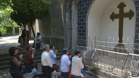 Catholics pray at Our Lady of Sheshan Basilica Catholic church in Shanghai on 24 May 2013