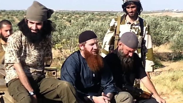 Omar Shishani (centre) and other Chechen fighters in Syria
