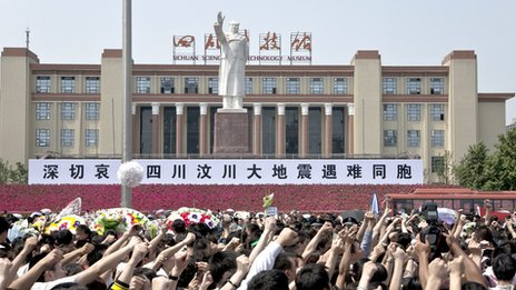 People gathered in the square to remember victims of the 2008 Sichuan Earthquake a week earlier, Chengdu Tianfu Square, 19 May 2008. This Mao Zedong statue was built in 1969.