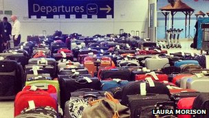 Suitcases lined up at Gatwick