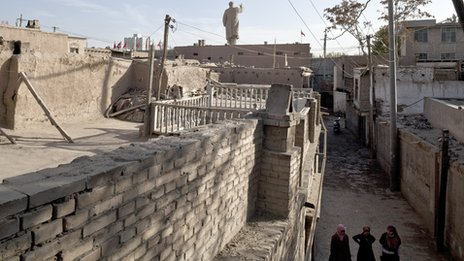 A 24-metre tall Mao statue, built in 1968, stands at the gate of a Uighur community, Kashgar, Xinjiang