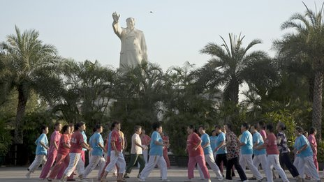 People dancing and exercising in front of a Mao statue Shijiazhuang City, Hebei Province, August, 2009.