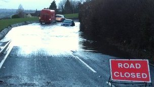 Cars trapped in flood water