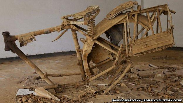 a rusting motorbike frame