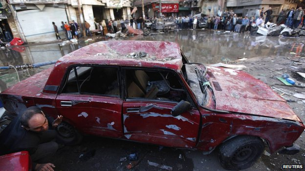 A damaged car is seen after the explosion in Mansoura.
