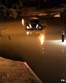 A mini stuck in flood water in Maidstone, Kent