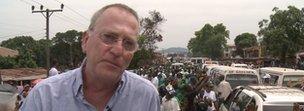 Mark Doyle wearing his glasses in Sierra Leone