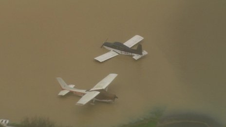 A helicopter caught this dramatic image of two light aircraft scattered and upturned at the Redhill Aerodrome in Surrey