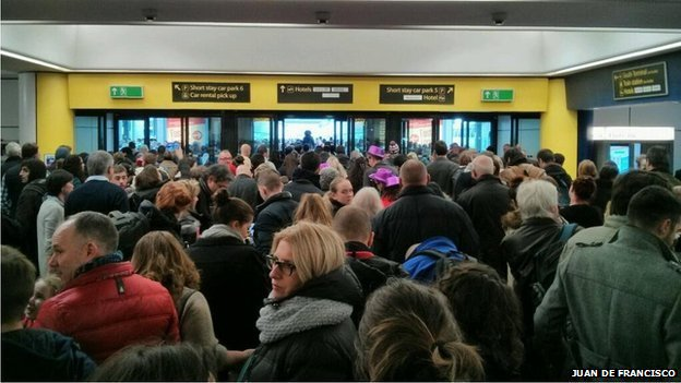 Crowds of travellers at Gatwick Airport