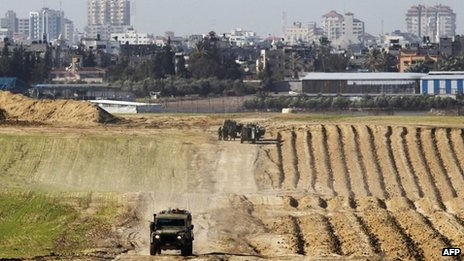 Israeli military jeeps are seen at the scene of a shooting incident near the border with the northern Gaza Strip near Nahal Oz