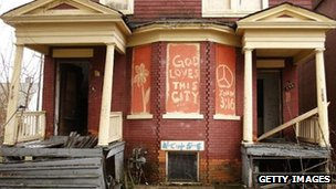 "Dilapidated house with ""God loves this city"" graffiti"