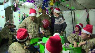 British soldiers looking at Christmas presents at Camp Bastion
