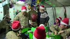British soldiers looking at Christmas presents at Camp Bastion
