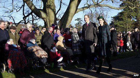 The Duke and Duchess of Cambridge walk through crowds of well-wishers on their way to the church