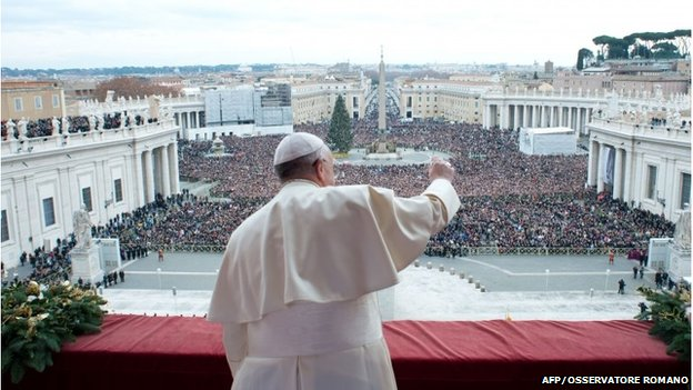 "Handout picture shows Pope Francis during his traditional Christmas ""Urbi et Orbi"" blessing from the balcony of St. Peter's Basilica"