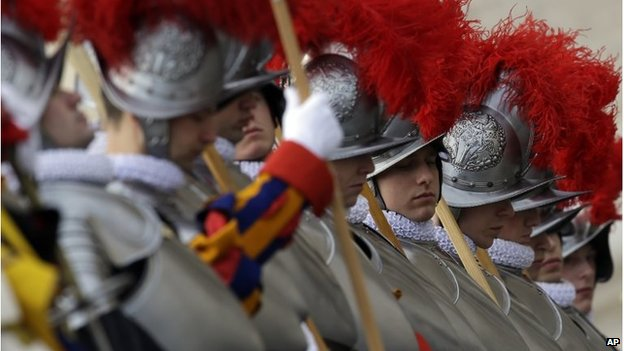 Swiss guards get ready prior to the start of Pope Francis Urbi et Orb message  December 25
