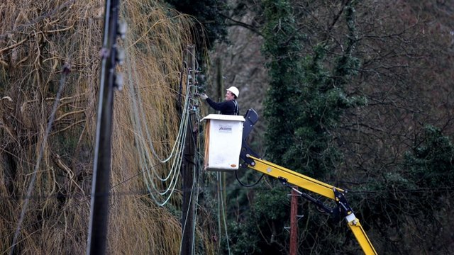 Man fixing power lines in Reigate