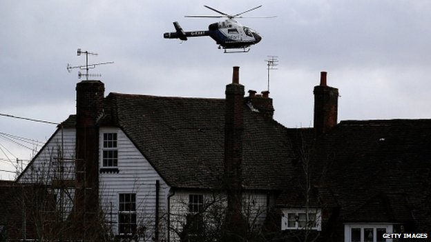 A helicopter flying over homes in Yalding