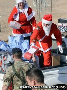 Troops from 3rd Regiment the Royal Artillery receive presents