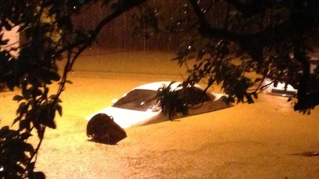 Car in floodwater in Bexon, St Lucia