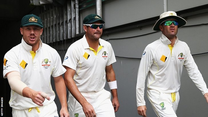 David Warner, Ryan Harris and Michael Clarke walk out to the field