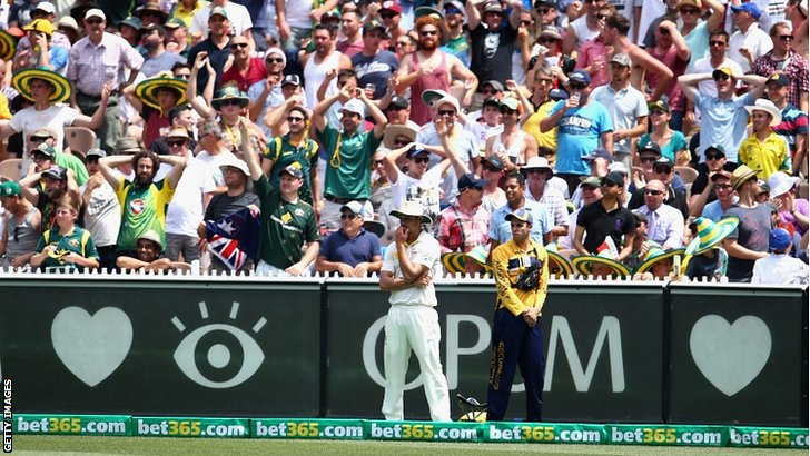 Nathan Coulter-Nile of Australia looks on after failing to catch Kevin Pietersen