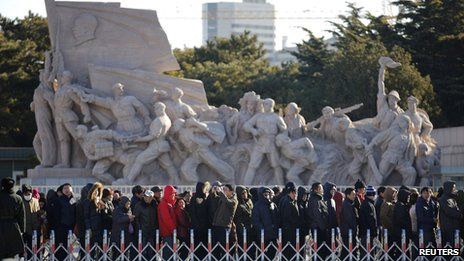 People stand in line to enter the Mausoleum of Mao Zedong in Beijing