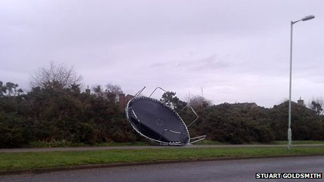 Trampoline blown across the road