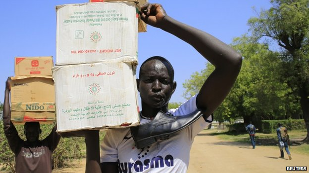 A man carries boxes of daily produce in Bor - 25 Dec