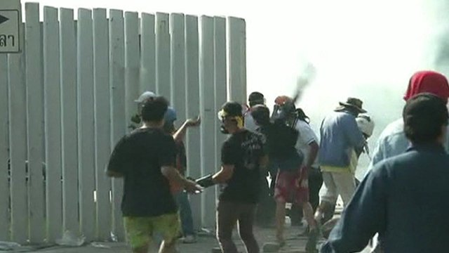 Anti-government protesters throwing rocks