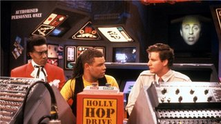 Danny John-Jules playing the Cat (l) in Red Dwarf