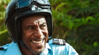 Danny John-Jules playing Officer Dwayne Myers in Death in Paradise
