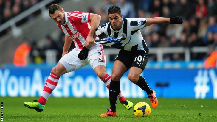Hatem Ben Arfa (right) in action for Newcastle