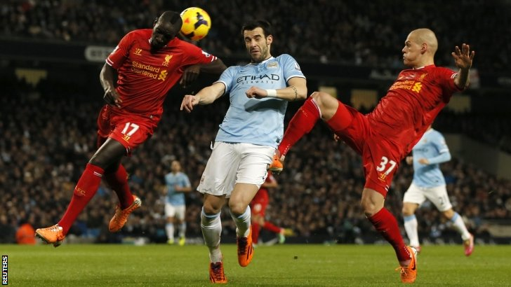 Liverpool's Mamadou Sakho (left) and Martin Skrtel (right) challenge Manchester City's Alvaro Negredo