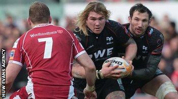 Richard Hibbard of Ospreys takes on John Barclay of Scarlets