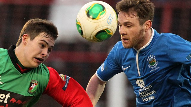 Jordan Stewart of Glentoran in action against Linfield's Jamie Mulgrew