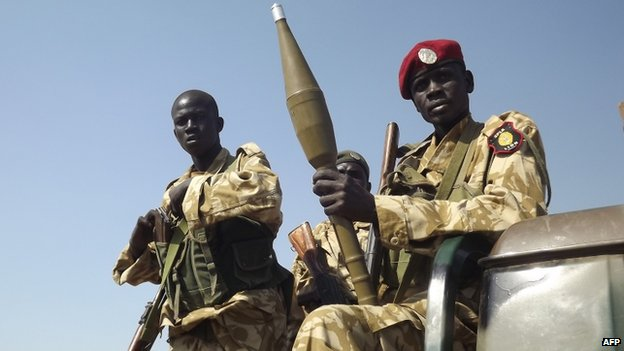 South Sudanese troops loyal to President Salva Kiir pictured at Bor airport after they re-captured it from rebel forces on 25 December 2013